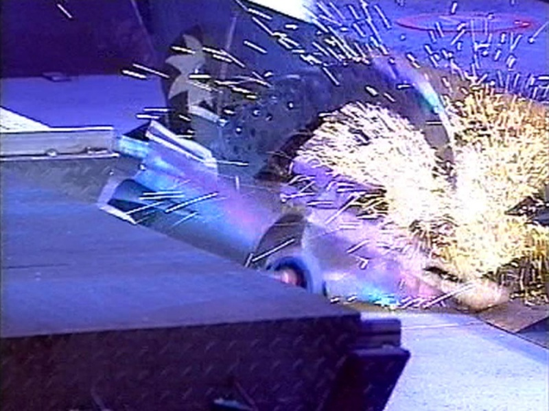 Robot Wars competitor Razer being showered in sparks by an arena hazard